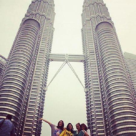 Petronas at last! Lol, way to ruin a moment, random tourist dude >_< Family @bebebear19 @elviehro