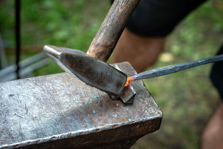Forge, blacksmiths work with hummer, hot metal. Blacksmith  Iron Anvil Bending Forging Metal Steel Craft Vintage Klutch Hot Tool Hand Forge  Close-up Equipment Hammer Work Tool Focus On Foreground Hand Tool Day Outdoors Selective Focus Working Iron - Metal High Angle View Tree