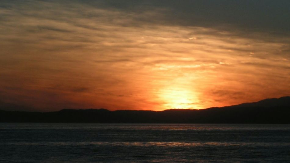 Sunset Nature Scenics Beauty In Nature Sea No People Tranquil Scene Outdoors Dramatic Sky Silhouette Beach Water Landscape Horizon Over Water An Eye For Travel