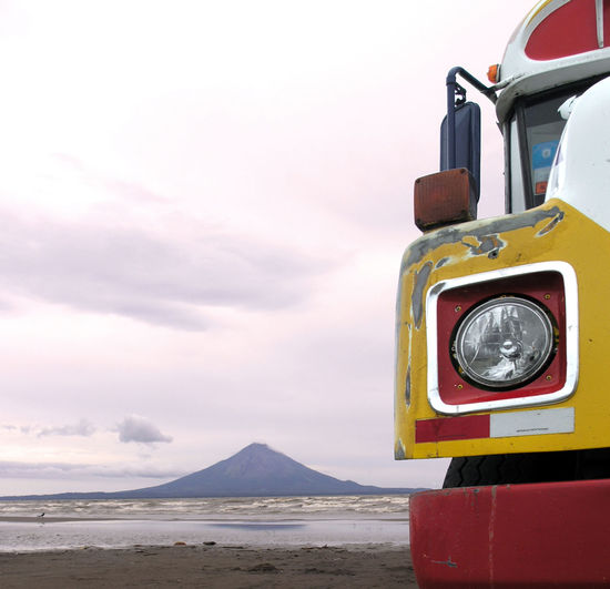bus near Ometepe Nicaragua Nicaragua Square Beach Bus Cloud - Sky Motor Vehicle Omatepi Ometepe Nicaragua Scenics - Nature Sky Transportation Travel Destinations Volcano Water