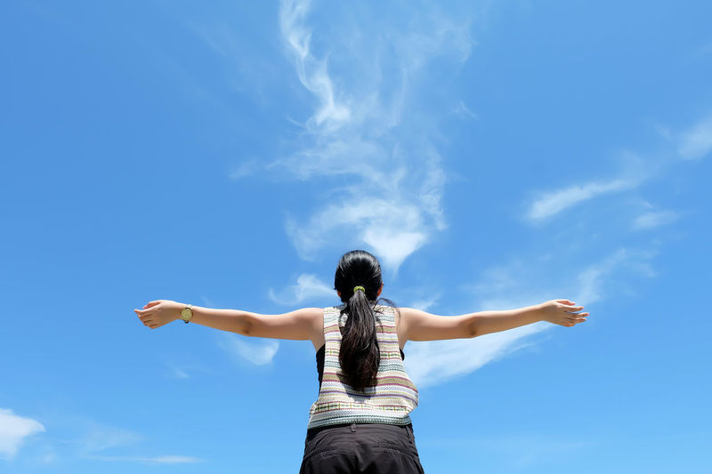 Arms Outstretched Arms Raised Blue Casual Clothing Childhood Cloud - Sky Day Energetic EyeEmNewHere Leisure Activity Lifestyles Low Angle View Nature One Person Outdoors People Real People Rear View Sky Standing Women