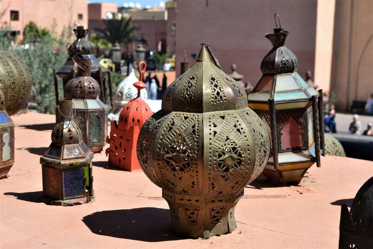 Moroccan lanterns on a window ledge in Marrakech, Morocco. Art And Craft Creativity Sunlight Craft Focus On Foreground No People Representation Day Close-up Antique Human Representation Architecture Metal Sculpture Variation Built Structure Outdoors Shadow Lighting Equipment Lantern Architectural Feature Moroccan Morocco Marrakech