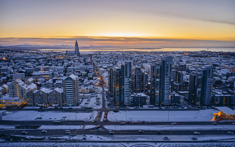 High angle view of city buildings during winter