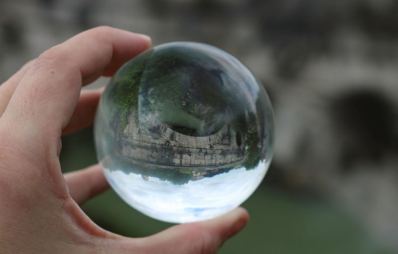 Rom Roma Rome Travel Photography Travelling Citytrip Close-up Crystal Ball Day Focus On Foreground Glass - Material Holding Human Body Part Human Hand Nature One Person Outdoors Personal Perspective Photography Photographylovers Sphere Transparent Unrecognizable Person Upside Down