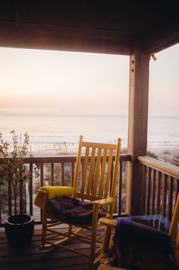 Rocking chairs in balcony at beach