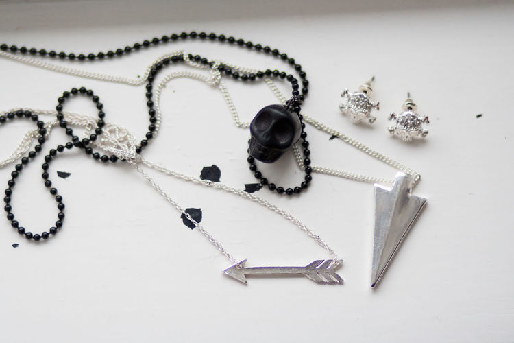 Arrow Accessories Bead Choice Close-up Earring  High Angle View Indoors  Jewelry Large Group Of Objects Luxury Metal Necklace No People Pearl Jewelry Pendant Personal Accessory Silver Colored Still Life Studio Shot Table Variation Wealth