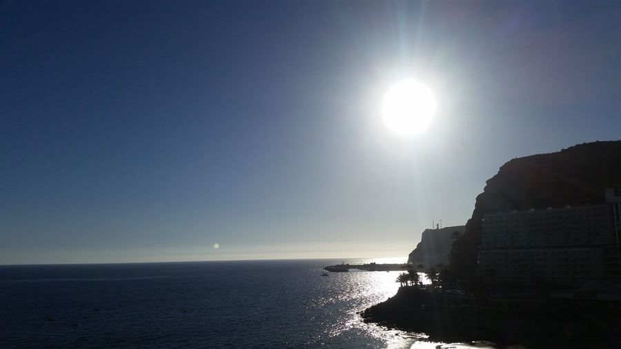 Sunset in Canarias Rocky Bay Cliffs Shimmering Sea Sunset Water Sea Clear Sky Beach Sun Silhouette Astrology Sign Sky Horizon Over Water