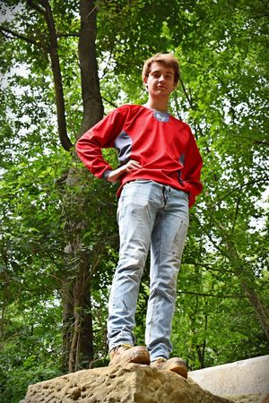 Standing tall Tree One Person Plant Casual Clothing Leisure Activity Day Nature Front View Adult Men Low Angle View Outdoors Real People Growth Smiling Standing Full Length Lifestyles Red Jeans