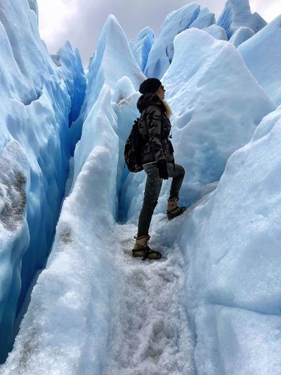 Patagonia Extreme Sports Crampons Glacier Ice Trekking Adventure Women Perito Moreno. Patagonia. Argentina. Trekking Effort Cold Temperature Winter Snow Leisure Activity Sport Extreme Sports Full Length One Person Mountain Adventure Winter Sport Warm Clothing Clothing Ice Frozen