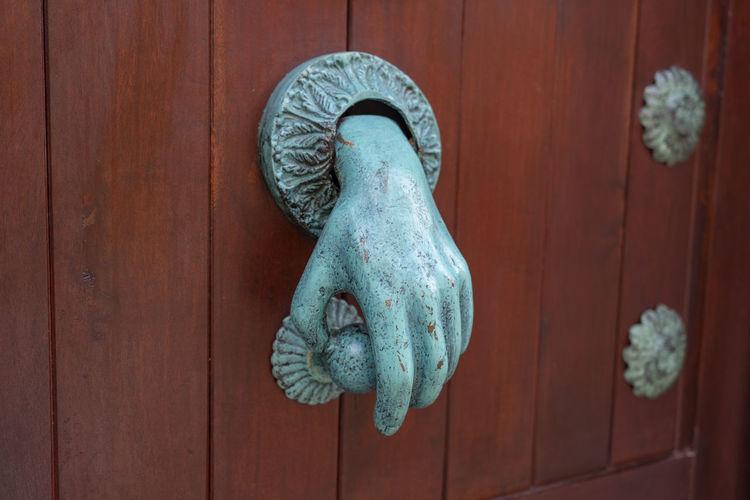 Close-up of knob on wooden door