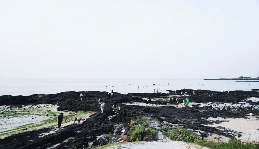 JEJU ISLAND  Jeju Island, Korea Sony A6300 Sea Water Beach Horizon Over Water Real People Nature Sky Standing Day Outdoors Large Group Of People Lifestyles Beauty In Nature Scenics Clear Sky Men People