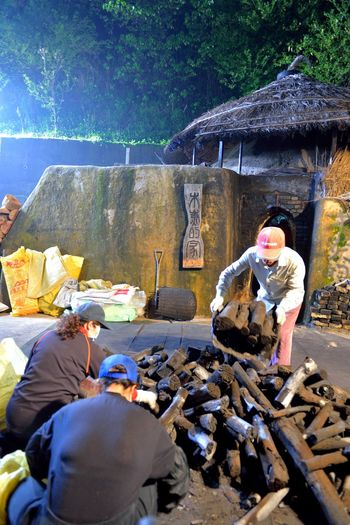 Making kiln-fired charcoal is a traditional handicraft industry. Charcoal Kilns In The Dark Hot Industry Toilet Tradition Adult Black Burn Wood Charcoal Day Economic Give Kiln Labor Force Men Outdoors People Real People Two People Work Hard