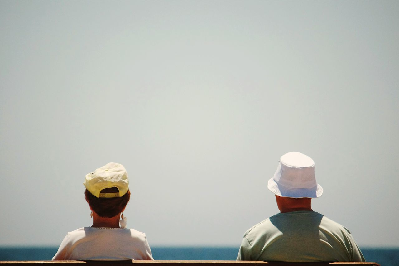 copy space, rear view, real people, nautical vessel, men, sea, headshot, clear sky, day, cap, water, two people, outdoors, sky, nature, close-up, people