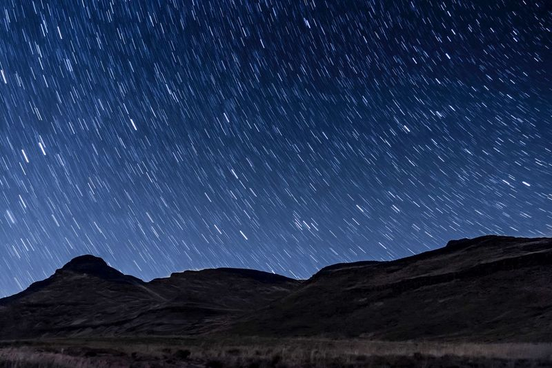 The Great Outdoors - 2017 EyeEm Awards Night Star - Space Mountain Star Trail Mountain Range Astronomy Tranquility Outdoors Landscape Nature Space Galaxy Beauty In Nature Sky Southafrica Summer