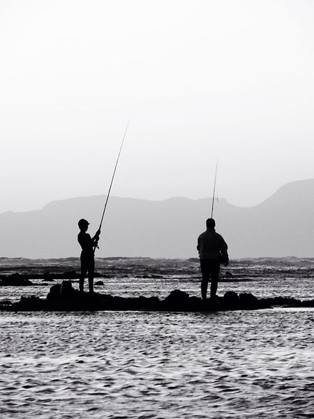 Fishing Father And Son Sea Rocks Standing On Waves Nature Catching Fish Fishing Rods