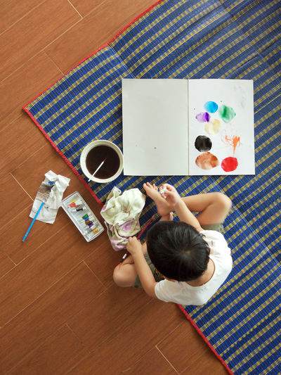High angle view of child painting