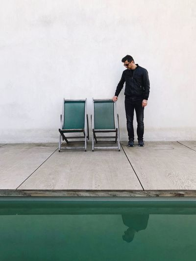 False hope Abandoned Reflection Mood Piscine Pool Green Color One Person Young Men Standing Full Length Young Adult One Man Only Day People Adult Be. Ready. Colour Your Horizn Inner Power Focus On The Story The Street Photographer - 2018 EyeEm Awards The Fashion Photographer - 2018 EyeEm Awards The Portraitist - 2018 EyeEm Awards The Fashion Photographer - 2018 EyeEm Awards