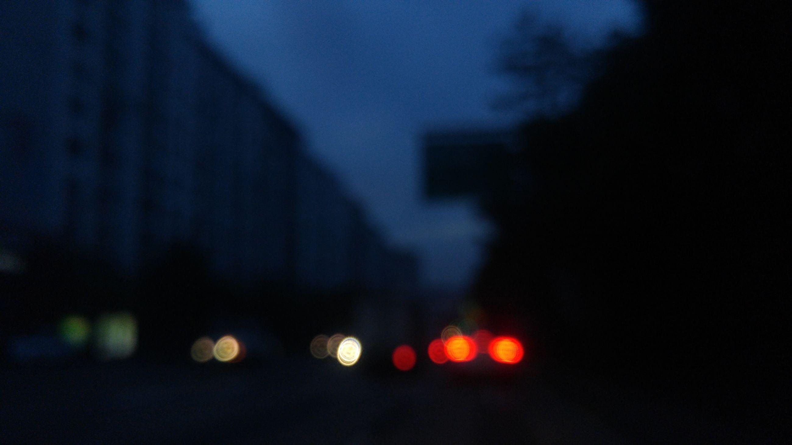 illuminated, night, defocused, dark, light - natural phenomenon, lighting equipment, glowing, street, sunset, sky, no people, city, silhouette, outdoors, street light, lens flare, car, light, road, dusk