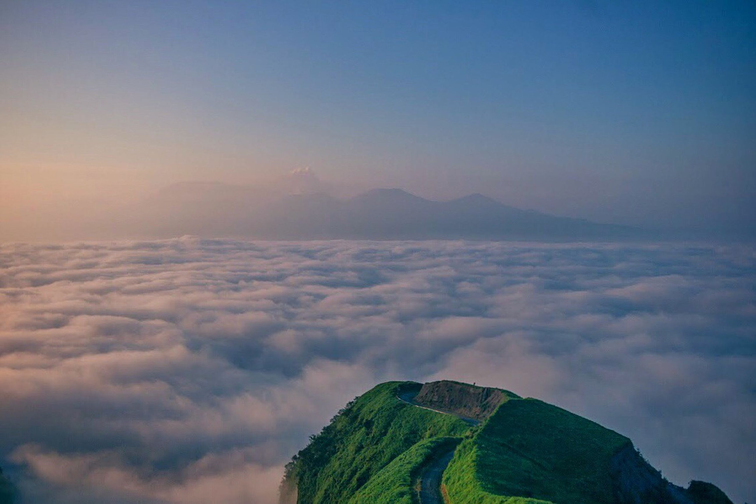 scenics, sky, beauty in nature, tranquil scene, tranquility, mountain, nature, cloud - sky, landscape, idyllic, cloud, outdoors, no people, blue, majestic, aerial view, day, high angle view, mountain range, remote