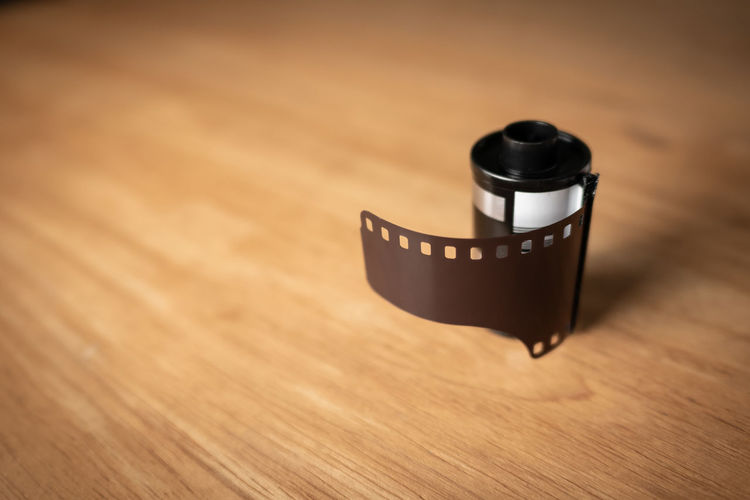 High Angle View Of Camera Film On Table
