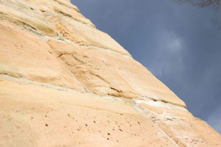 Close-up view of yellow stone wall