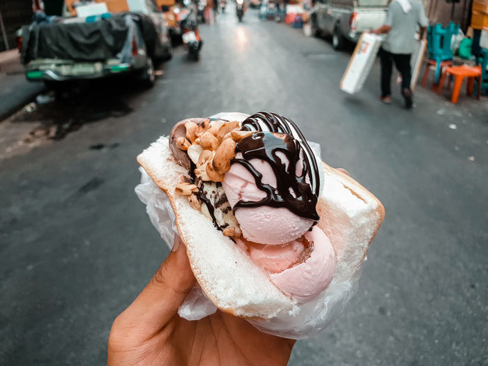 Midsection of ice cream on street
