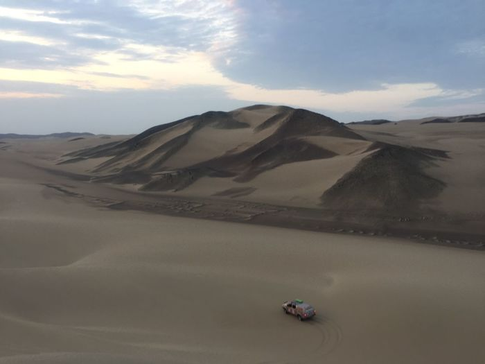 Arid Climate Beauty In Nature Climate Cloud - Sky Day Desert Environment Land Landscape Mountain Mountain Range Nature Non-urban Scene Outdoors Sand Sand Dune Scenics - Nature Sky Tranquil Scene Tranquility Transportation Travel
