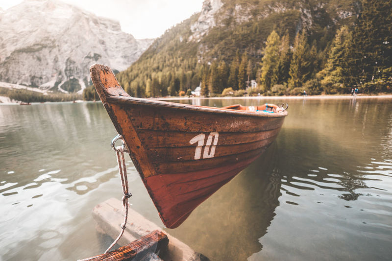 Beauty In Nature Day Lake Mode Of Transportation Moored Mountain Nature Nautical Vessel No People Non-urban Scene Outdoors Plant Reflection Rowboat Scenics - Nature Tranquil Scene Tranquility Transportation Tree Water