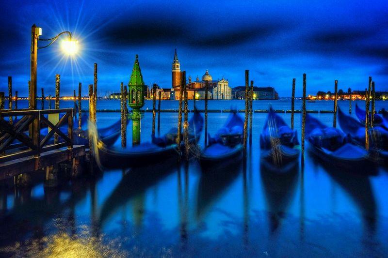 Gondolas moored at grand canal during night