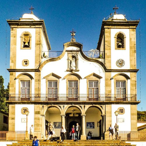 Nossa Senhora do Monte Architecture Built Structure Building Exterior Building Sky City Group Of People Incidental People Religion Place Of Worship Travel Destinations Belief History Spirituality Real People Window The Past Day Outdoors Clock