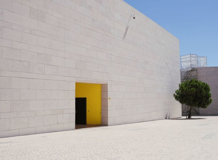 Portugal Roadtrip Impressions Paint The Town Yellow Architecture Architecture_collection Fuji X-T20 Minimalist Architecture X-T20 Architectural Detail Architecture Building Exterior Built Structure Color Day Minimal Minimalism Minimalobsession Modern No People Outdoors Sky Travel Destinations Yellow The Week On EyeEm The Graphic City