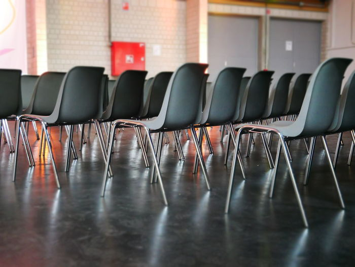 Berlin Business Event Meeting Waiting Absence Arrangement Chair Chairs Conference Empty Folding Chair Furniture In A Row Indoors  No People Perfection Seat Waiting Room Modern Workplace Culture