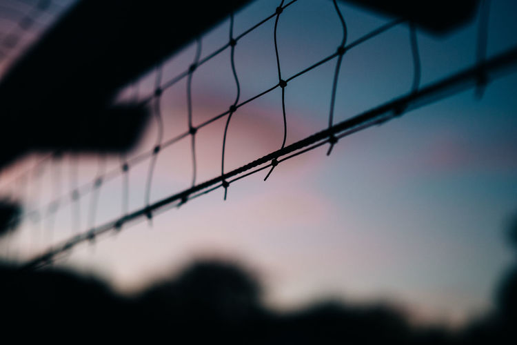 Sunset Silhouettes Backgrounds Barrier Boundary Close-up Cloud - Sky Day Dusk Fence Focus On Foreground Low Angle View Nature Net - Sports Equipment No People Outdoors Pattern Selective Focus Silhouette Sky Sport Sunset HUAWEI Photo Award: After Dark 17.62°