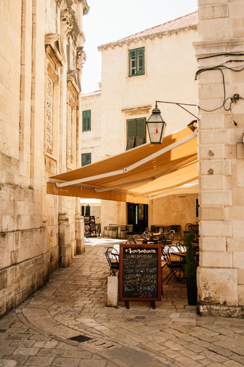 Little cafe in side street of Dubrovnik Croatian Style Drinks Strolling Alley Architecture Building Building Exterior City Dubrovnik Explore No People Old Outdoors Outside Cafe Retro Styled Southern Style Tourist Atrraction Travel Travel Destinations