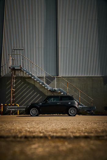 Mini Side View 2 Mini Cooper Architecture Black Color Built Structure Car City Factory Industry Metal Mode Of Transportation Motor Vehicle No People Staircase Transportation