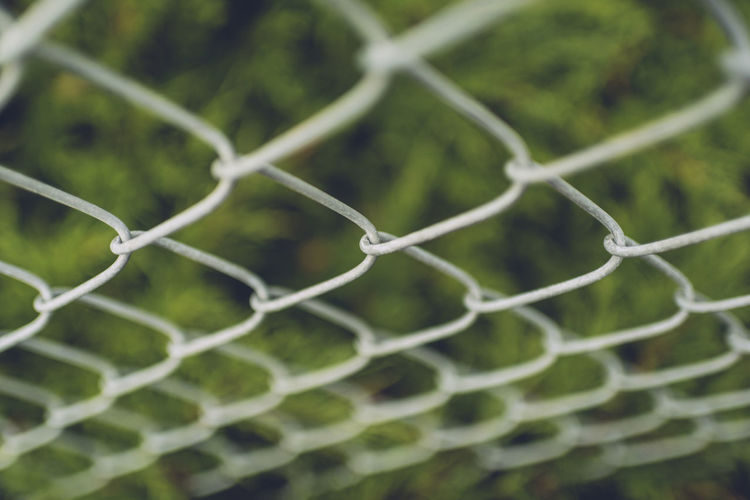 Backgrounds Barrier Boundary Chainlink Fence Close-up Day Fence Focus On Foreground Full Frame Green Color Metal Nature No People Outdoors Pattern Plant Protection Safety Security Selective Focus