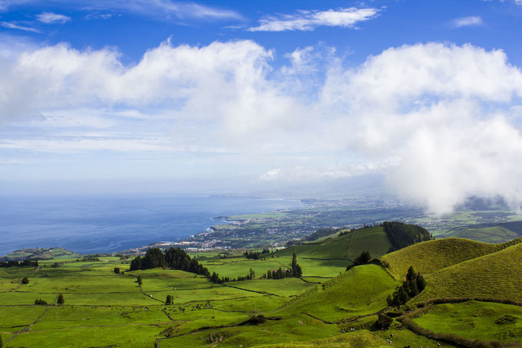 Landscape with Farm Fields and atlantic ocean Atlantic Ocean Azores Scenic Agriculture Beauty In Nature Cloud - Sky Environment Field Grass Green Color Hill Idyllic Land Landscape Nature Non-urban Scene Ocean Outdoors Rolling Landscape Rural Scene Scenics - Nature Sea Tranquil Scene Tranquility Vibrant Color