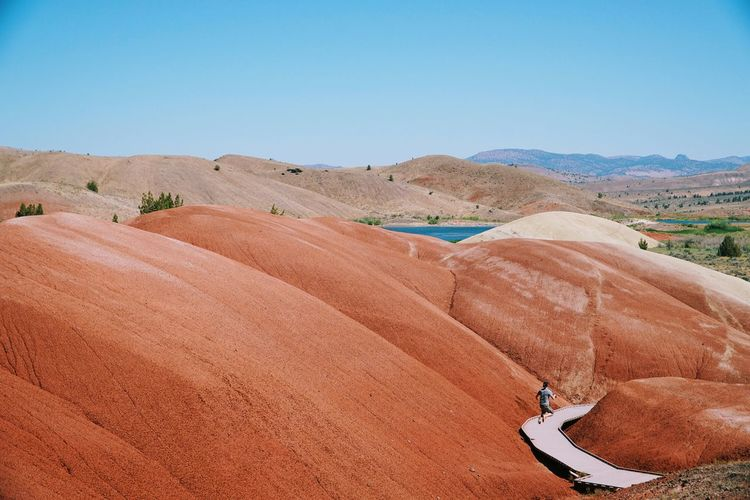 Scenic view of painted hills against sky