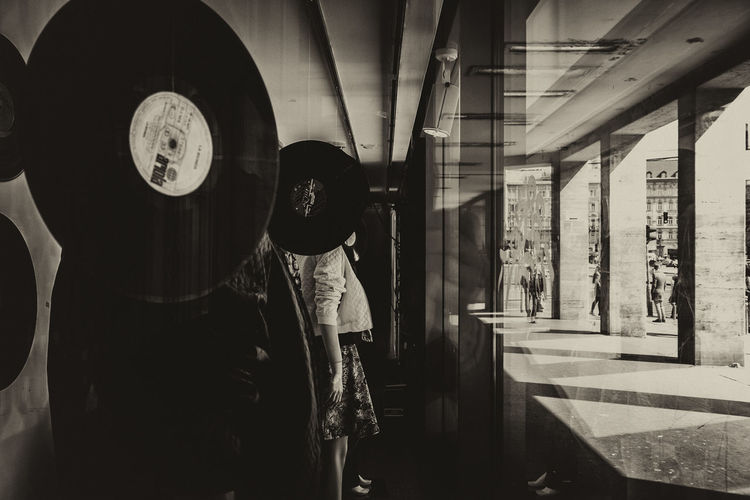 A photo made from a shopwindow towards the street. They are watching... Bakelite Blackandwhite Inside Out Reflection Shopwindow Streetphotography