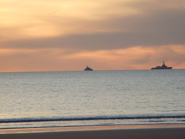 Beauty In Nature Sunset Sky Sea White Background Offshore Platform Transportation Water Day Cloud - Sky Scenics No People Horizon Over Water Beach Nautical Vessel Orange Color Tranquil Scene Nature Tranquility Sun Silhouette Sunlight