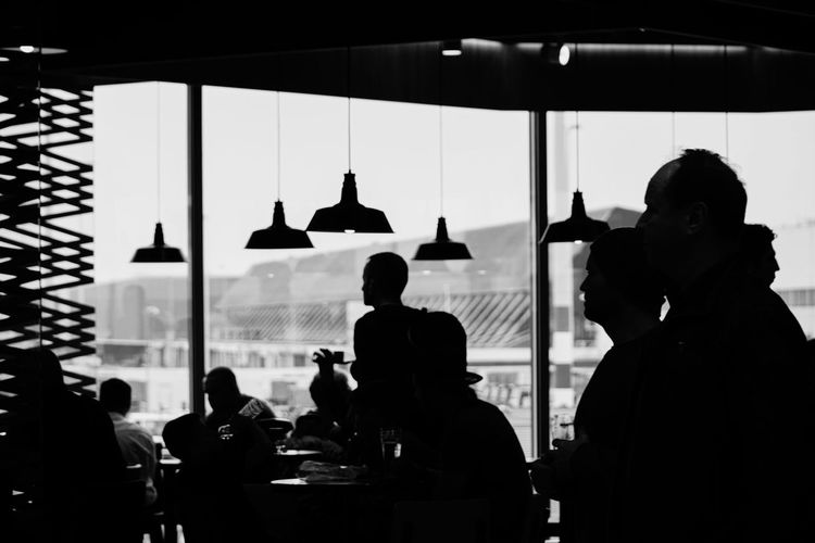 Silhouette people in restaurant