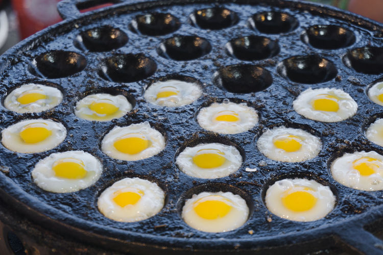 Baking Sheet Breakfast Close-up Cooking Pan Egg Egg Yolk Food Food And Drink Freshness Fried Egg Healthy Eating High Angle View Indoors  Indulgence Kitchen Utensil No People Pan Preparation  Preparing Food Ready-to-eat Selective Focus Still Life Temptation Tray Wellbeing