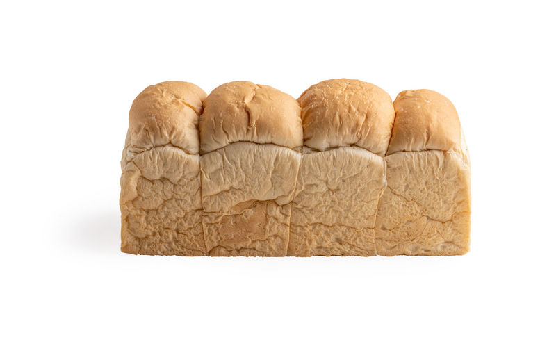 Close-up of bread against white background