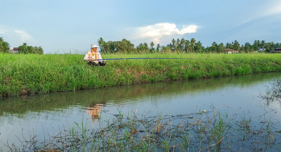 Fishing Water Rice Paddy Tree Farmer Irrigation Equipment Rural Scene Cereal Plant Agriculture Working Occupation Agricultural Field Growing Fishing Rod Countryside Fisherman