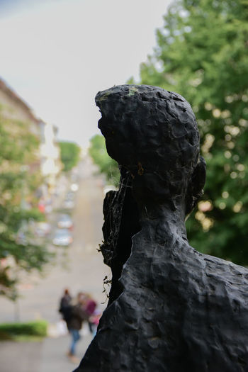 Architecture Art And Craft Close-up Craft Creativity Day Female Likeness Focus On Foreground Human Representation Male Likeness Nature No People Outdoors Plant Representation Sculpture Selective Focus Solid Statue Tree