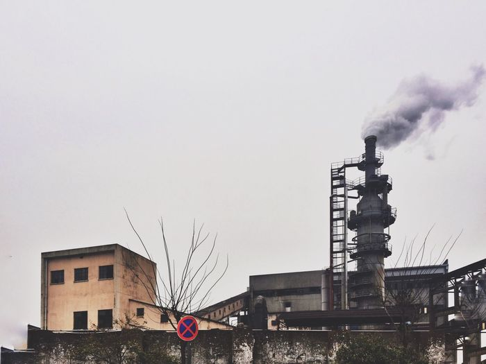 Smoke Emitting Through Industry Against Clear Sky