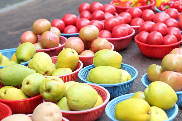 High angle view of fruits in container on floor