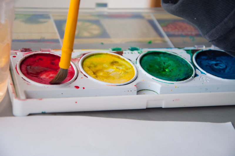 Using some watercolour paints Colourful Paint Paint Brush Child Painting Multi Colored Paint Tray Watercolor Painting Watercolours