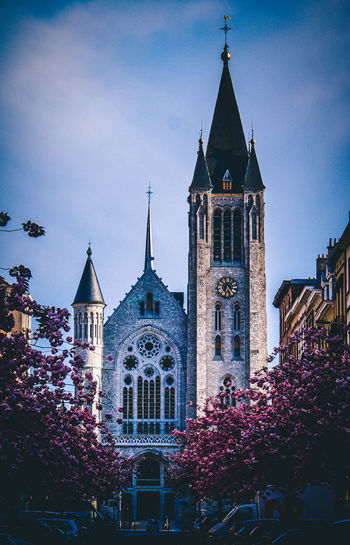 Saint-Antoine Church Architecture Building Exterior Built Structure Building Religion Sky Place Of Worship Belief Spirituality Tower Plant Nature Tree Day Travel Destinations City Outdoors No People Spire  Church Flower Street Streetphotography Springtime Decadence