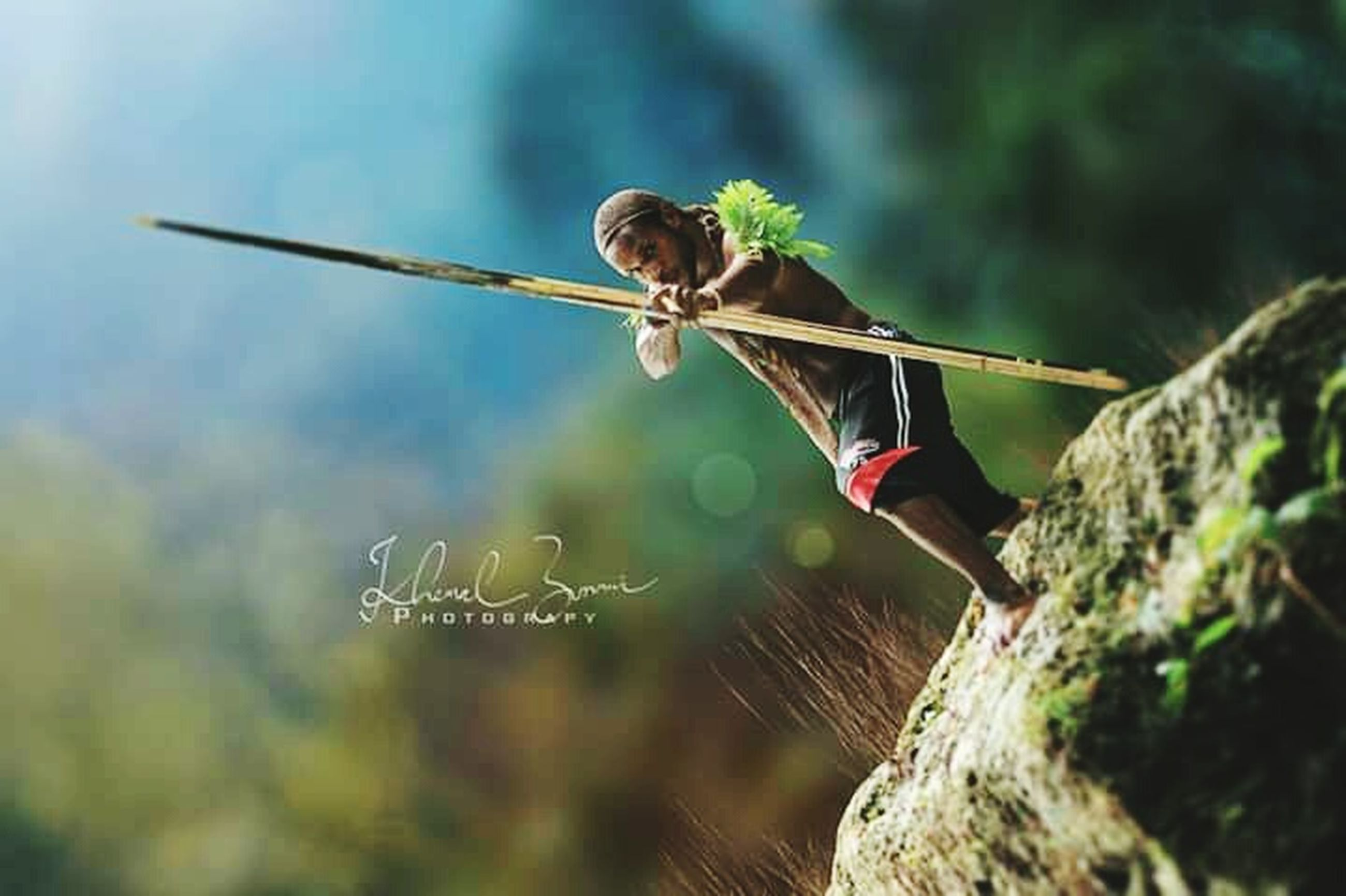 one person, leisure activity, day, concentration, nature, sport, skill, adult, selective focus, young adult, outdoors, determination, full length, focus on foreground, lifestyles, holding, women, limb, athlete, human arm